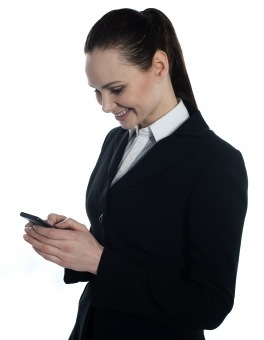 Woman reading SMS on smartphone